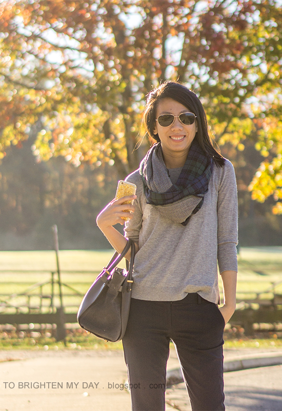navy/green plaid and herringbone infinity scarf, gray button back sweater, navy pants, gray tote