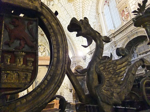 The interior of the Toledo Cathedral, with a dragon guarding the gate in