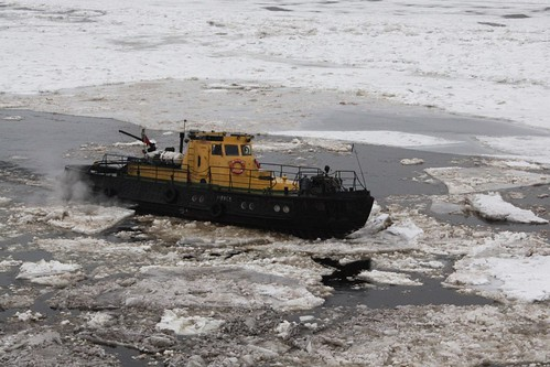 Breaking up slabs of ice on the River Neva