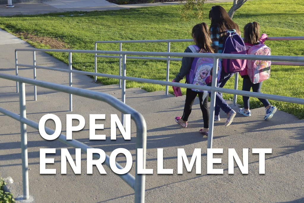 Three students walking down steps to school with text 'Open Enrollment'
