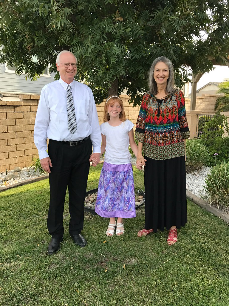 With grandparents and homemade skirt