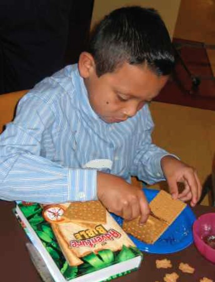 Building a graham cracker house - part of a storytelling kit for the Four Friends