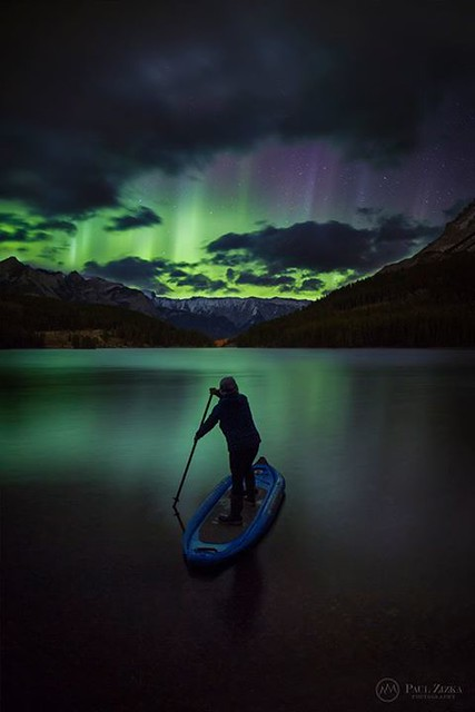 """Aurora Paddler"" Sue Shih launches across Two Jack Lake as the aurora lights up the sky. A magical night in the mountains."