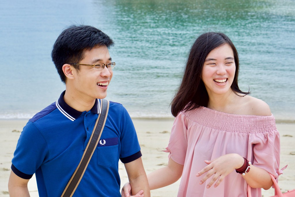 Joshua & Tiffany laughing at Siloso Beach.