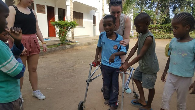 Helping Kevoo with his walking frame