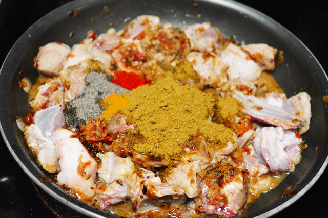 Adding spices for Indian mutton gravy