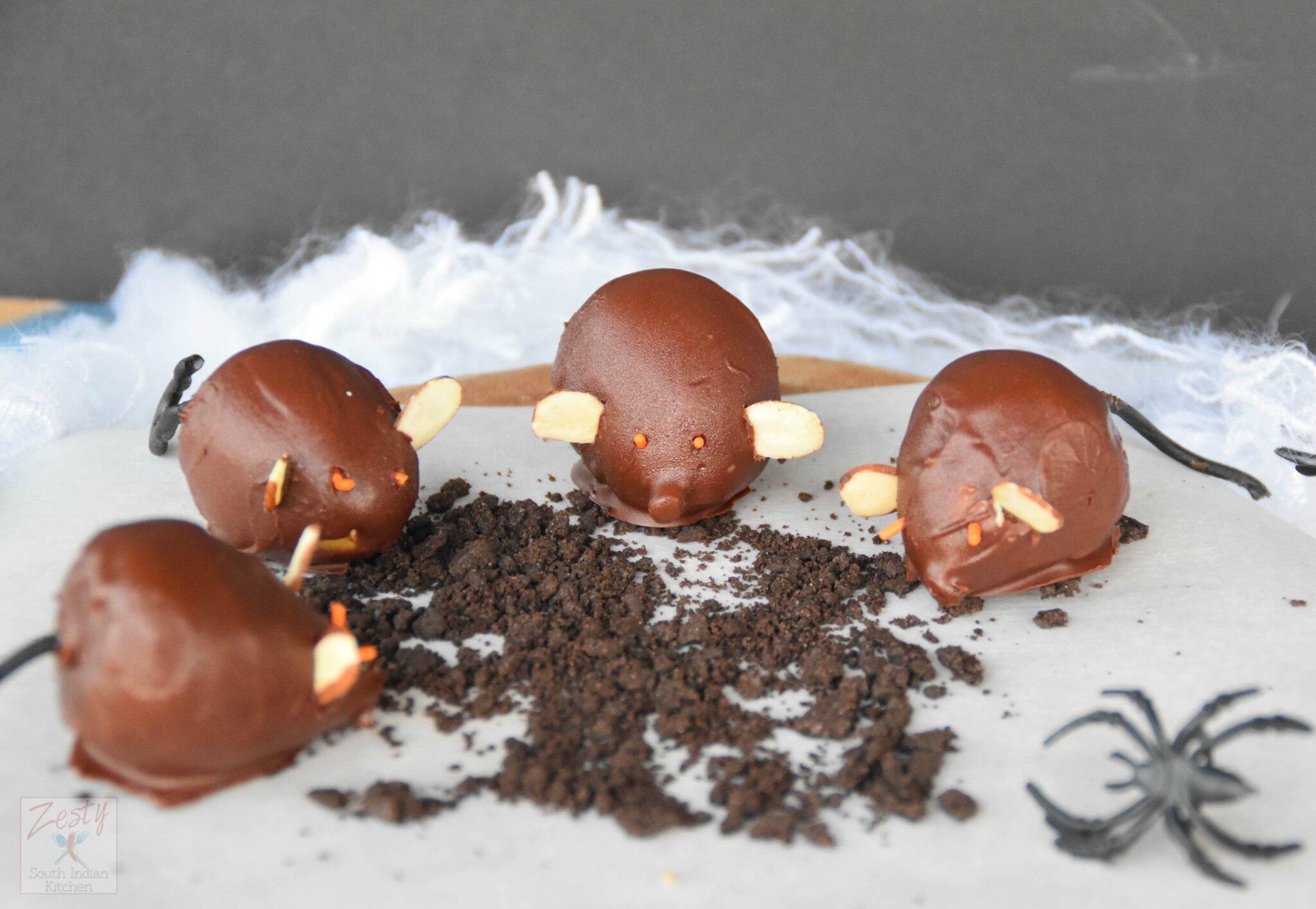 "<img src=""https://cdn.shortpixel.ai/client/q_glossy,ret_img,w_2048,h_1415/Chocolate fig mice.jpg"" alt="" Chocolate fig mice 2"">"