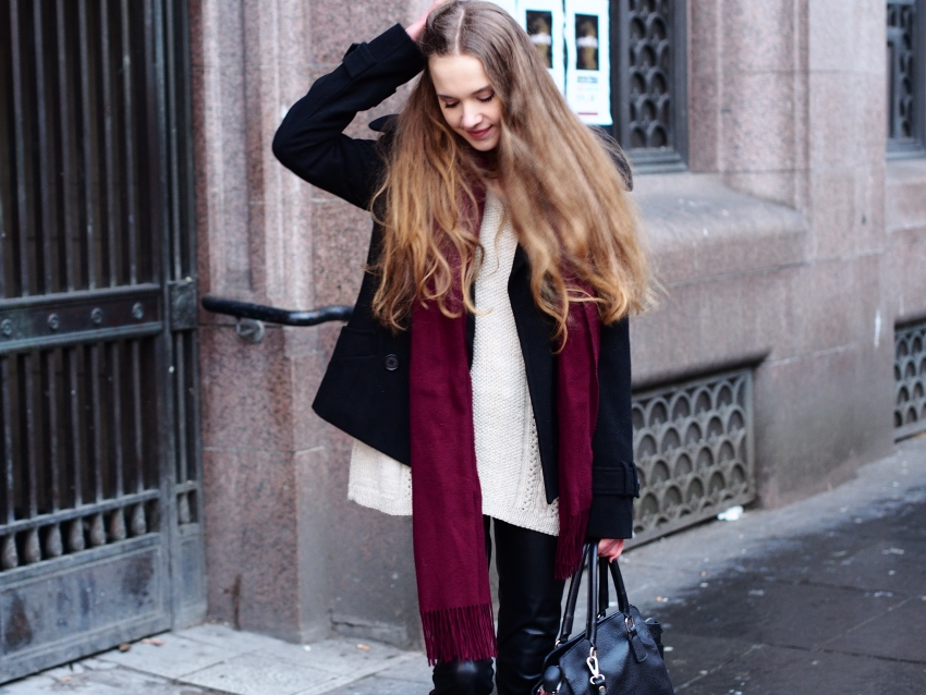 winter fashion with sweaters and faux leather trousers