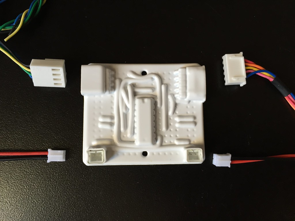 Circuit board covered with vacuum formed plastic with cables and connectors