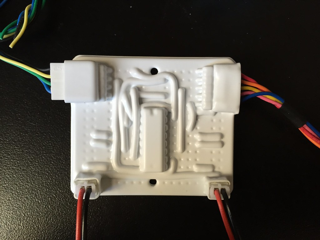 Circuit board covered with vacuum formed plastic with cables connected
