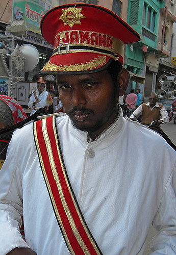 A man playing in a brass band for the wedding parade