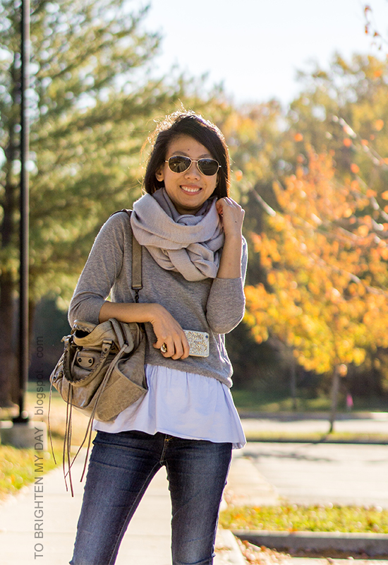 gray scarf, gray button back sweater layered over baby blue peplum top, skinny jeans, gray moto bag