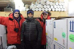 Dr. Scott Borg (Antarctic Infrastructure and Logistics Section Head, NSF), Dr. Murat Aydin (Chief Scientist, South Pole Ice Core), and Vladimir Papitashvili (Antarctic Astrophysics and Geospace Sciences Program Director) inside the core storage trench