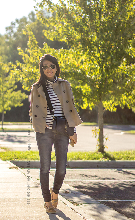 camel trench cape jacket, striped oversized turtleneck, skinny jeans, black crossbody bag with canvas strap, boat shoes