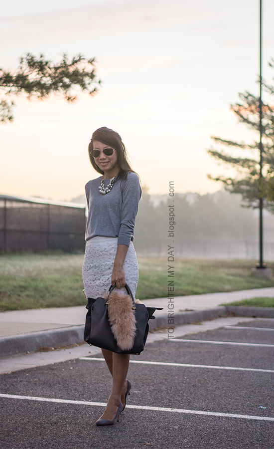 mixed pearl necklace, gray button back sweater, white floral lace pencil skirt, gray tote bag accessorized with faux fur scarf, gray suede pumps