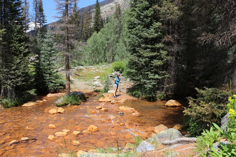 Fording rust-stained Rock Creek