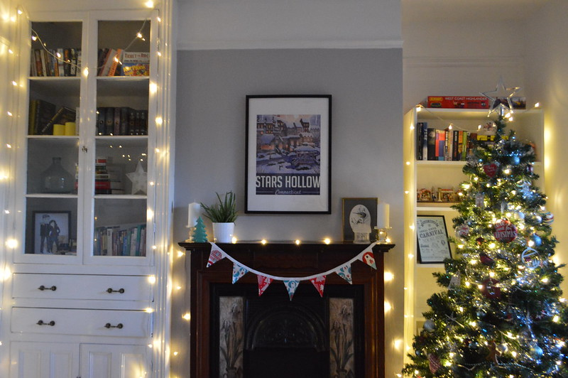 this is a photo of a dining room with a christmas tree and fairy lights