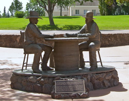Cooley and Clark card game statue