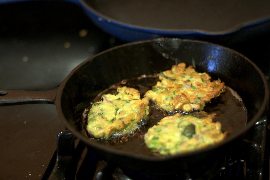 zucchini fritters frying