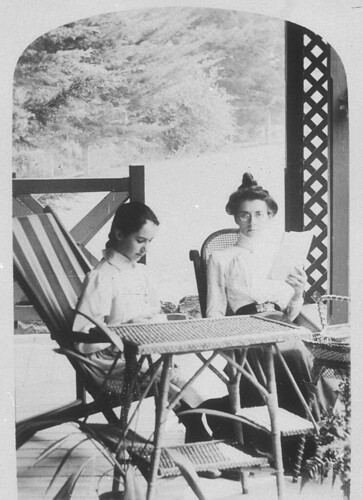 "Girl reading on the verandah of ""Sandilands"" station with her French governess, Agnes Bruxner, Miss Gouley - Tabulam area, NSW,  c. 1898 
