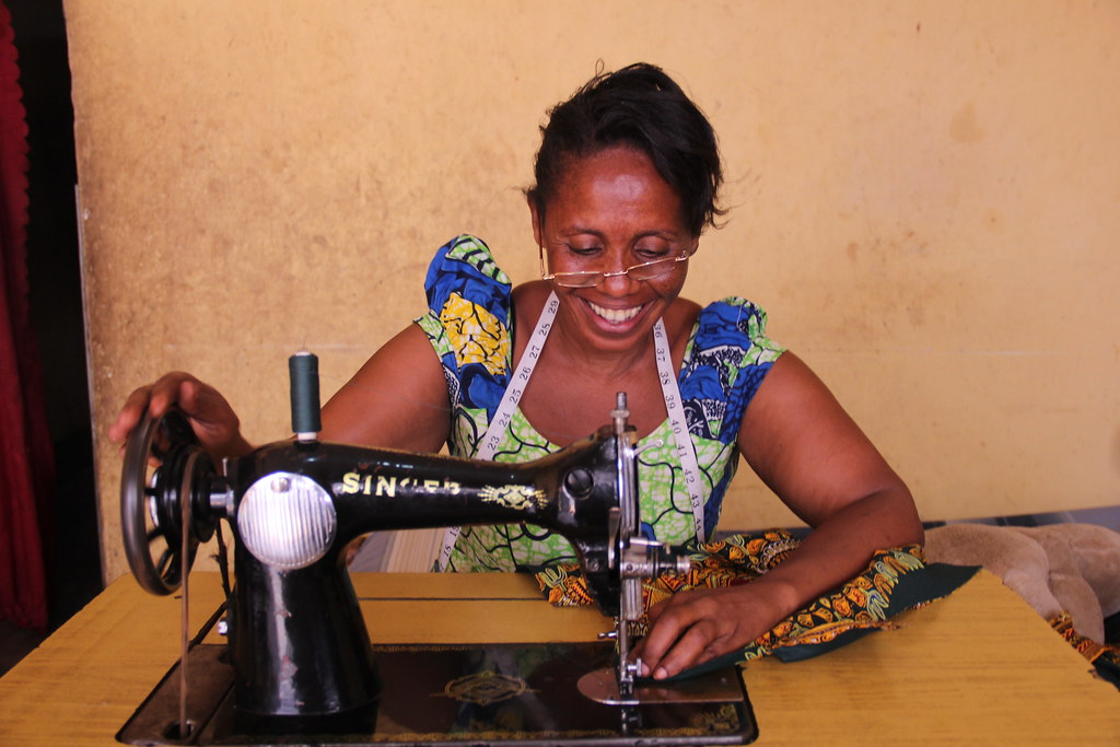 Rebecca, a Congolese refugee living in Kampala and working as a tailor