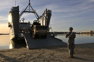 Loading vehicles | by The U.S. Army