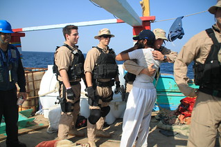 Sailors from USS Kidd assist an Iranian-flagged fishing dhow. | by Official U.S. Navy Imagery
