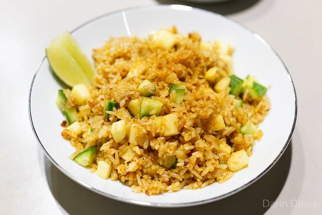 Pungent seasoned rice, chili jam, salted duck egg yolk, bonito powder, crispy garlic