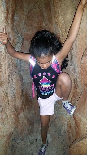 Aja climbing the bat cave at the museum