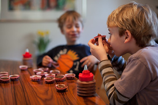 Beck conducts quality control while Lucas eats another cupcake | by Lars Plougmann