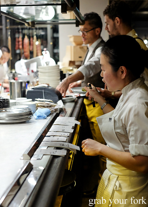 Chef callign dockets on the pass at Mercado restaurant, Sydney