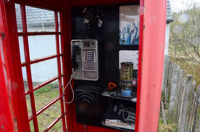 Cooking up with the jetboil in a phone box, Altnaharra, Scotland.