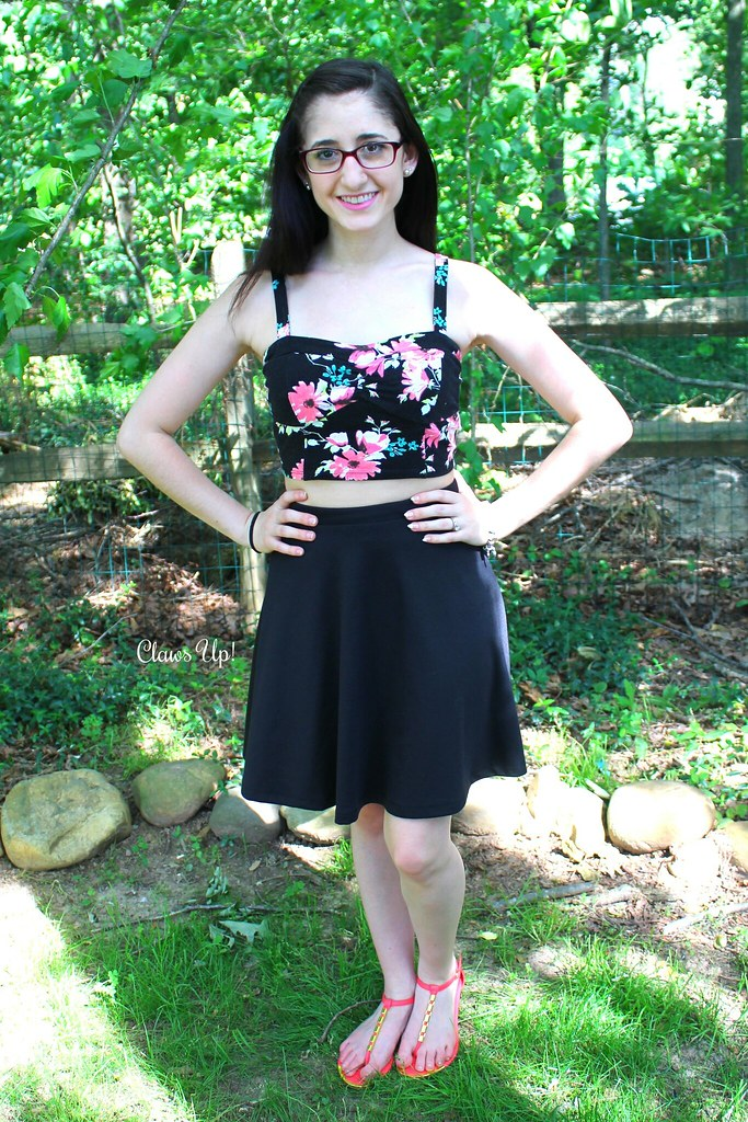 Black floral crop top with a black a line skirt.