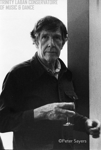 Photograph of John Cage at a drinks reception at the Cage/Cunningham Residency at the Laban Centre, Laurie Grove, London, July 1980
