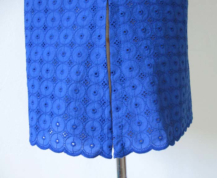 side hem view blue eyelet top
