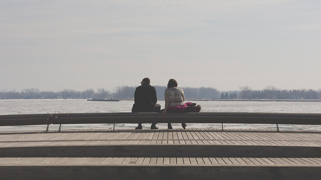 Man And Woman On A Bench