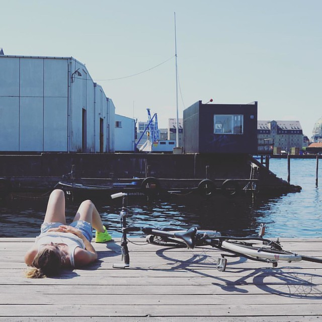 Enjoying the last rays on Paper Island. #Copenhagen #summercycling #sunnydays #cyclechic