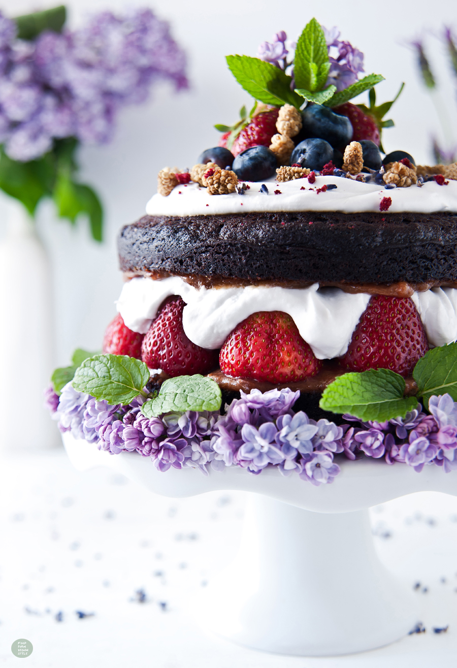 Vegan carob layer cake (tort) with coconut whipped cream, strawberries and rhubarb