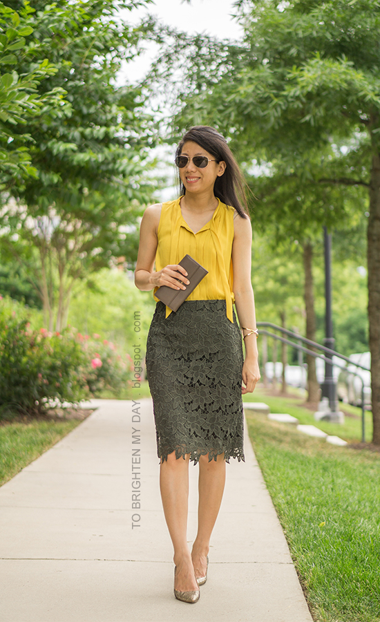 sleeveless mustard yellow pleated top, gold cross bracelet, taupe clutch, olive green lace pencil skirt, glitter pumps