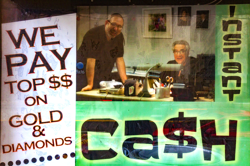 INSTANT-CASH-with-photos-of-two-smiling-men--Cleveland