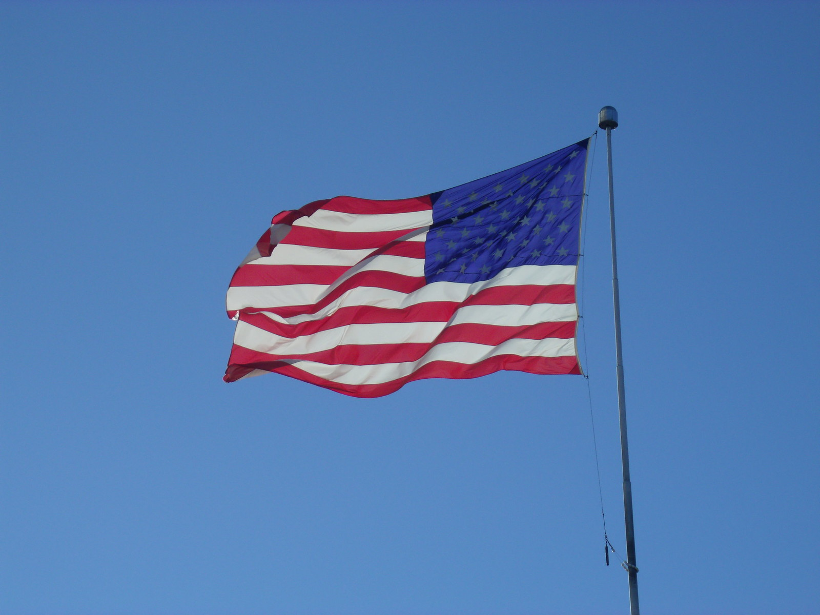 American Flag Under Blue Sky By Sherrie D. Larch