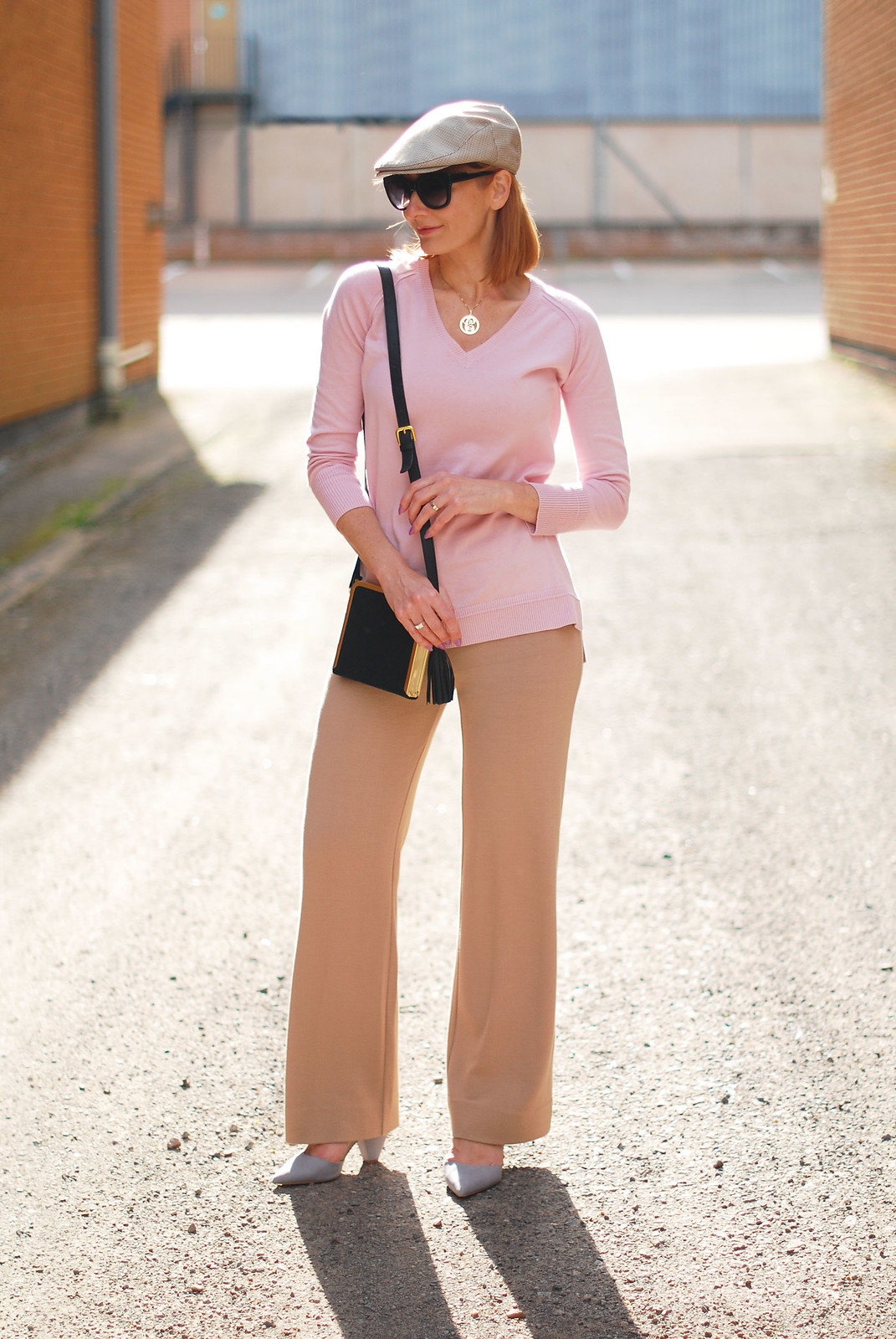 Winser London pale pink sweater, camel wide leg trousers, black cross body bag, flat cap, grey heels | Not Dressed As Lamb