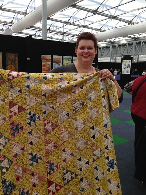 Holding Linda's original Panama pyramids quilt