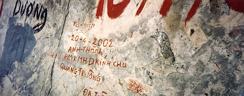 Graffiti on the wall of a cave on the way to the island of Cat Ba in Vietnam