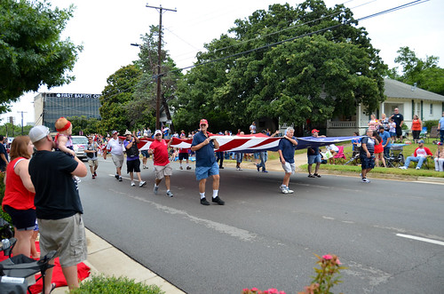 Carrying a large flag