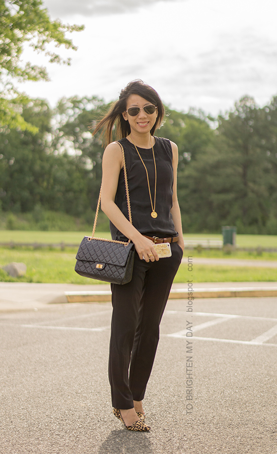 black sleeveless silk top, brown belt, gold jewelry, black pants, leopard flats