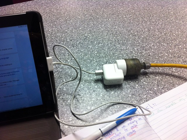 Charging up the IPad with a power cable, connector via USB.
