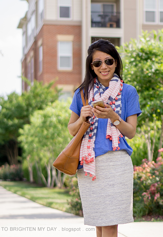 striped and pom pom scarf, cornflower blue t-shirt, tweed pencil skirt, oversized watch