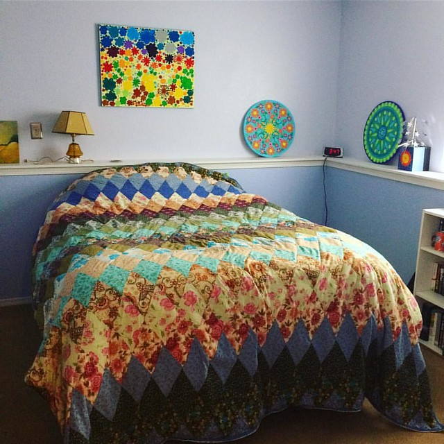 The quilt I made my mother looks pretty good in our guest room.