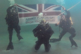 Royal Navy Divers Hold the Armed Forces Day Flag | by Defence Images